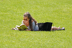 © Licensed to London News Pictures. 23/06/2020. Sheffield , UK. A woman reading a book in the warm weather at Endcliffe Park, Sheffield . The Met Office has issued warnings as the UK is set to bask in temperatures reaching a sweltering 33 degrees celsius across the UK.Photo credit: Ioannis Alexopoulos/LNP