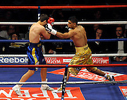 Amir Khan connects with a left hook during the WBA Light Welterweight title fight between Amir Khan (Challenger) and Andreas Kotelnik (Champion) at the MEN Arena on July 18, 2009 in Manchester, England.