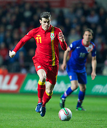 SWANSEA, WALES - Tuesday, March 26, 2013: Wales' Gareth Bale in action against Croatia during the 2014 FIFA World Cup Brazil Qualifying Group A match at the Liberty Stadium. (Pic by Kieran McManus/Propaganda)