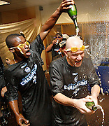 OT_294424_CASS_rays_21<br /> BRIAN CASSELLA   |   Times<br /> (09/26/2008 DETROIT) B.J. Upton, J.P. Howell and Rays celebrate their first A.L. East division title at 12:55 a.m. in the clubhouse at Comerica Park.<br /> <br /> MAJOR LEAGUE BASEBALL - Tampa Bay Rays vs Detroit Tigers at Comerica Park in Detroit on Friday (9/26/08).
