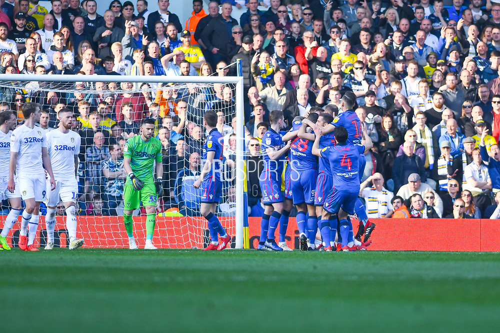Bolton Wanderers team celebrate after Mark Beevers of Bolton Wanderers (5) scores to make the score 1-1 during the EFL Sky Bet Championship match between Leeds United and Bolton Wanderers at Elland Road, Leeds, England on 23 February 2019.