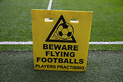 'Beware Flying Footballs' signage on the pitch at Stamford Bridge ahead of the Premier League match between Chelsea and West Ham United at Stamford Bridge, London, England on 8 April 2019.