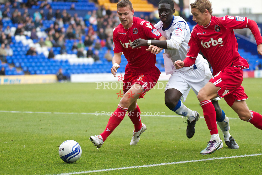 BIRKENHEAD, ENGLAND - Sunday, September 19, 2010: Tranmere Rovers' Arnaud Mendy in action against Charlton Athletic's Simon Francis during the Football League One match at Prenton Park. (Photo by Vergard Grott/Propaganda)