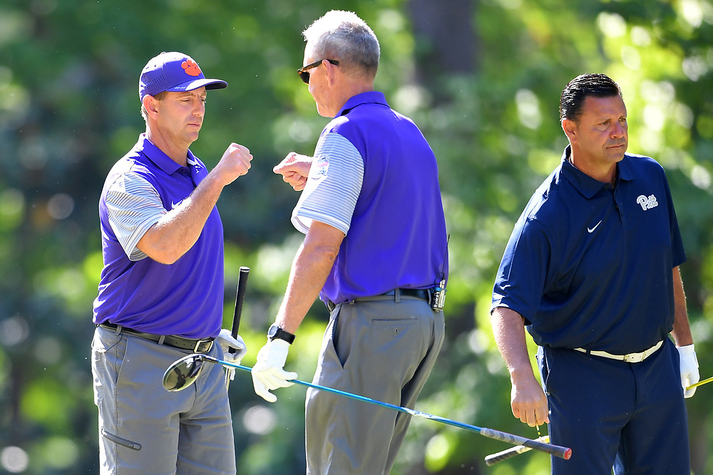 Dabo Swinney reacts with Steve Fuller during the Chick-fil-A Peach Bowl Challenge at the Oconee Golf Course at Reynolds Plantation, Sunday, May 1, 2018, in Greensboro, Georgia. (Dale Zanine via Abell Images for Chick-fil-A Peach Bowl Challenge)