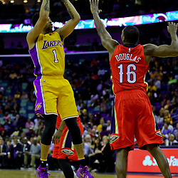 Apr 8, 2016; New Orleans, LA, USA; Los Angeles Lakers guard D'Angelo Russell (1) shoots over New Orleans Pelicans guard Toney Douglas (16) during the first quarter of a game at the Smoothie King Center. Mandatory Credit: Derick E. Hingle-USA TODAY Sports