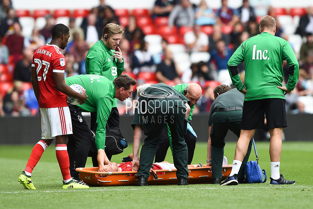 Nottingham Forest defender Tendayi Darikwa (27) looks over Nottingham Forest midfielder Ben Osborn (11) who is stretchered off injured during the Pre-Season Friendly match between Nottingham Forest and Burnley at the City Ground, Nottingham, England on 29 July 2017. Photo by Jon Hobley.