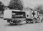 World War I 1914-1918: Wounded German soldiers on stretchers in a motorised ambulance painted with the Red Cross, Eatern Front, 1915. Military, Army, Medicine, Casualty, Automobile
