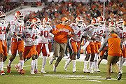 Clemson Tigers head coach Dabo Swinney connects arms with his team as they prepare for the National Championship game at Raymond James Stadium in Tampa, Monday, January 9, 2017.