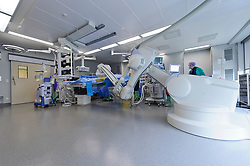 Dr. Lieven Maene, of the OLV Hospital, in Aalst, Belgium, uses the Artis Zeego's 3D imaging capabilities to repair an aneurism. The Artis Zeego, manufactured by Siemens AG, is the first multi-axis angiography system based on robotic technology that can be used in the operating room. (Photo © Jock Fistick)