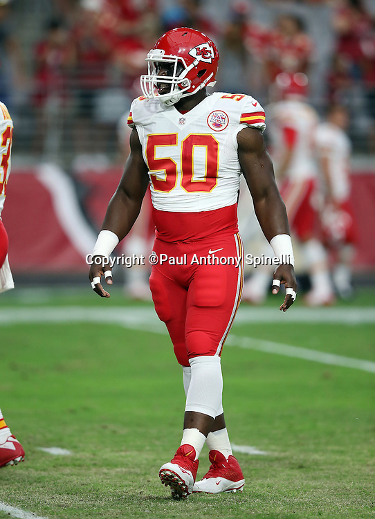 Kansas City Chiefs outside linebacker Justin Houston (50) looks on during the 2015 NFL preseason football game against the Arizona Cardinals on Saturday, Aug. 15, 2015 in Glendale, Ariz. The Chiefs won the game 34-19. (©Paul Anthony Spinelli)
