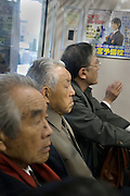 elderly businessmen commuters Tokyo Japan