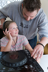 Adult helping a child to use a turntable at Greenlane Youth Centre; Nottingham,