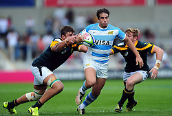 Juan Cruz Mallia of Argentina U20 takes on the South Africa U20 defence - Mandatory byline: Patrick Khachfe/JMP - 07966 386802 - 25/06/2016 - RUGBY UNION - AJ Bell Stadium - Manchester, England - Argentina U20 v South Africa U20 - World Rugby U20 Championship 2016 3rd Place Play-Off.