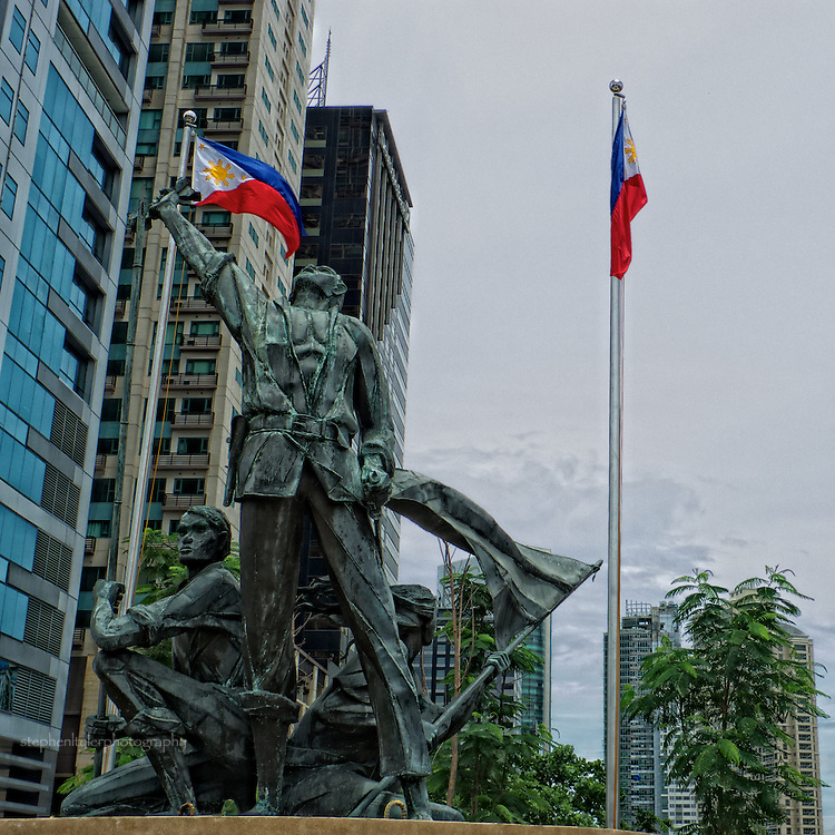 A statue of national hero Andres Bonifacio beneath the towers at the intersection where Rizal Drive and 3rd Ave converge at 32nd Street, near an entry point into Fort Bonifacio Global City
