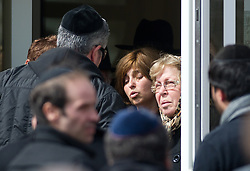 """People leaving The """"Ozar Hatorah"""" Jewish school after a funeral ceremony, on March 20, 2012 in Toulouse, southwestern France. The bodies of three French-Israeli children and a Jewish teacher killed in a gun attack began their journey Tuesday from the school where they died to their burial in Israel..The bodies were due to be flown from Paris Charles de Gaulle airport later Tuesday for a funeral in Israel. Photo by i-Images"""