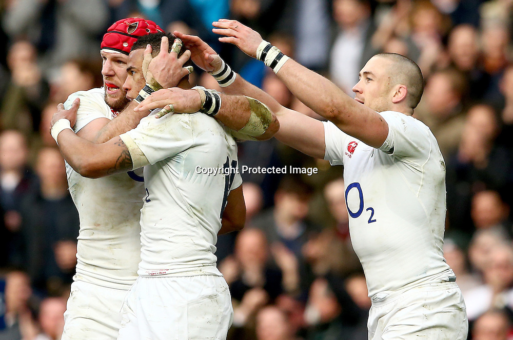 RBS 6 Nations Championship Round 4, Twickenham Stadium, London, England 12/3/2016<br /> England vs Wales<br /> England's James Haskell celebrates with try scorer Anthony Watson and Mike Brown<br /> Mandatory Credit &copy;INPHO/James Crombie