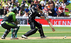 New Zealand's Kane Williamson, right, bats in front of Pakistan's Sarfraz Ahmed in the fifth one day International Cricket match, Basin Reserve, Wellington, New Zealand, Friday, January 19, 2018