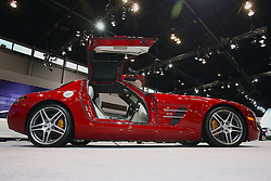 08 February 2012: 2012 MERCEDES-BENZ SLS AMG: Joining the Mercedes-Benz SLS AMG Coupe with gullwing doors, is the all-new open-top 2012 SLS AMG Roadster. Both SLS AMG models are powered by a front/mid 6.2-liter V8 that socks-out a whopping 563 horsepower and 479 lb. ft. of torque to the rear wheels. When revved, the distinctive AMG eight-cylinder sound brings a smile even to harden auto enthusiasts. Engines come with a fuel-efficient rear transaxle AMG seven-speed dual-clutch automatic transmission. Reports claim that the SLS AMG bursts from zero to sixty mph in 3.6 seconds. Prominent features of the two-seat, aviation-inspired cockpit include the wing-shape dashboard, finest leather, matte-finished solid metal or optional, genuine carbon-fiber trim and E-Select lever in the shape of an aircraft's thrust control. Three soft top colors – black, red and beige – are available to suit the nine exterior and eight interior colors. The compact fabric soft top of the Roadster opens and closes in just eleven seconds, and can be operated on the move at speeds up to 31 mph. Window sticker is in the $200,000 price range. Chicago Auto Show, Chicago Automobile Trade Association (CATA), McCormick Place, Chicago Illinois