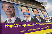 The anti-EU membership 'UK Independence Party's (UKIP) political billboard shows leader Nigel Farage and a gagged Prime Minister David Cameron, Labour party leader Ed Milliband and (coaltion) Deputy PM Nick Clegg - all silent against a bullying European Union, seen in East Dulwich - a relatively affluent district of south London. The ad is displayed before European elections on 22nd May.