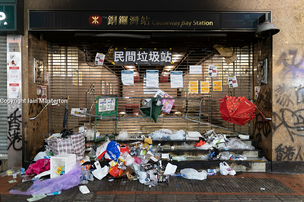 Hong Kong. 6 October 2019. Tens of thousands of pro-democracy protestors march in pouring rain through centre of Hong Kong today from Causeway Bay to Central. Peaceful march later turned violent as a hard-core of protestors confronted police. Pic; Vandalised entrance to Causeway Bay MTR station. Iain Masterton/Alamy Live News.