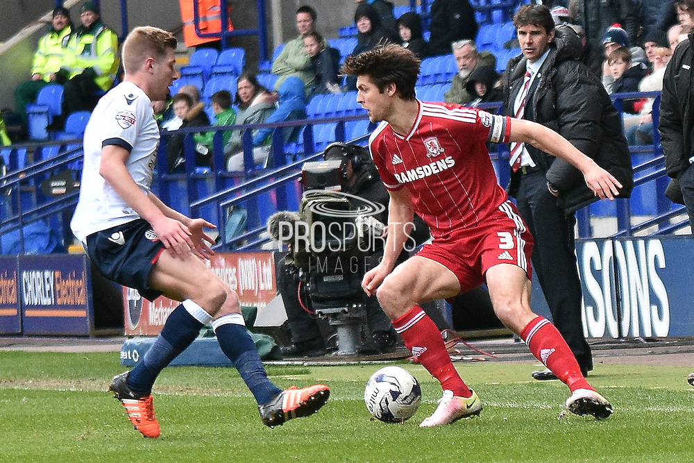 Middlesbrough Defender, George Friend on the ball during the Sky Bet Championship match between Bolton Wanderers and Middlesbrough at the Macron Stadium, Bolton, England on 16 April 2016. Photo by Mark Pollitt.