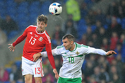 Lloyd Isgrove of Wales challenges for the header with Aaron Hughes of Northern Ireland - Mandatory by-line: Dougie Allward/JMP - Mobile: 07966 386802 - 24/03/2016 - FOOTBALL - Cardiff City Stadium - Cardiff, Wales - Wales v Northern Ireland - Vauxhall International Friendly