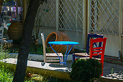 colourful chairs and tables in garden cafe