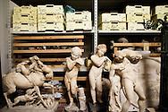 Ercolano, Italia - 23 novembre 2012. Statue di età romana ritrovate all'interno degli scavi archeologici di Ercolano (Herculaneum) conservate in un deposito dello stesso sito. Il sito archologico di epoca romana, patrimonio dell'Unesco, distante solo pochi km da Pompei, ha riportato alla luce tesori antichi di inestimabile valore. A differenza di Pompei, ad Ercolano sono stati ritrovati reperti organici ed in legno che hanno permesso agli archeologi di studiare in modo più approfondito le abitudini dell'epoca. Ph. Roberto Salomone Ag. Controluce.ITALY - Statues of roman age are seen in a deposit inside the archeological site of Herculaneum on November 23, 2012. The world heritage site of roman age, just a few miles away from Pompeii has brought to life treasures that made it possible for archeologists to study in a more detailed way the lifestyle of ancient romans.