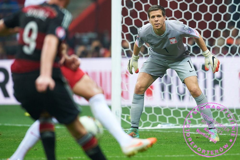 Poland's goalkeeper Wojciech Szczesny looks on the ball during the EURO 2016 qualifying match between Poland and Germany on October 11, 2014 at the National stadium in Warsaw, Poland<br /> <br /> Picture also available in RAW (NEF) or TIFF format on special request.<br /> <br /> For editorial use only. Any commercial or promotional use requires permission.<br /> <br /> Mandatory credit:<br /> Photo by &copy; Adam Nurkiewicz / Mediasport