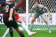Poland's goalkeeper Wojciech Szczesny looks on the ball during the EURO 2016 qualifying match between Poland and Germany on October 11, 2014 at the National stadium in Warsaw, Poland<br /> <br /> Picture also available in RAW (NEF) or TIFF format on special request.<br /> <br /> For editorial use only. Any commercial or promotional use requires permission.<br /> <br /> Mandatory credit:<br /> Photo by © Adam Nurkiewicz / Mediasport