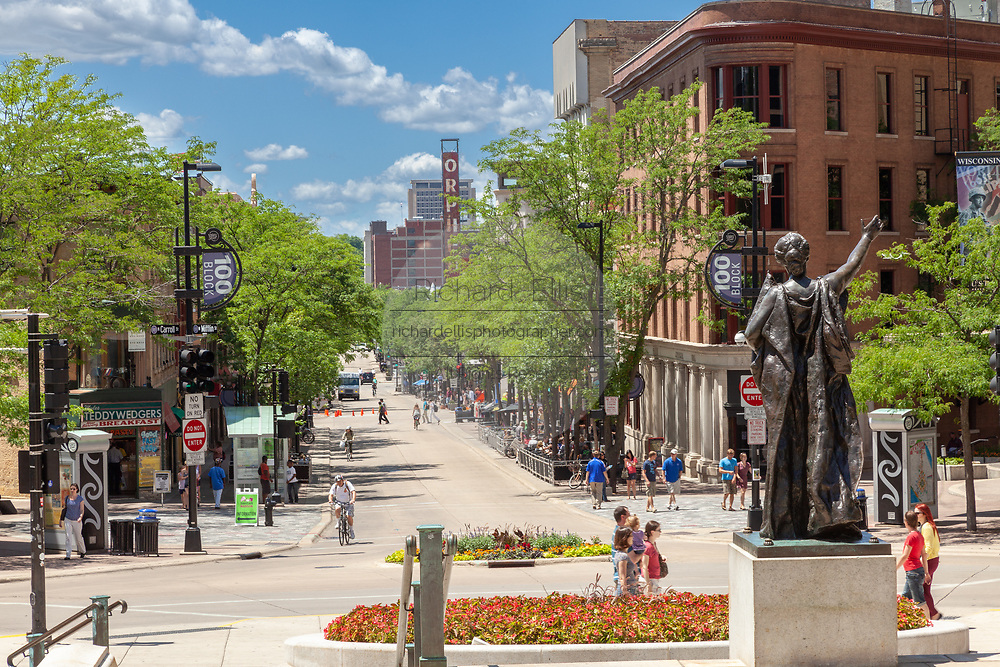 The statue Forward on Capital Square looking down State Street in Madison, Wisconsin.