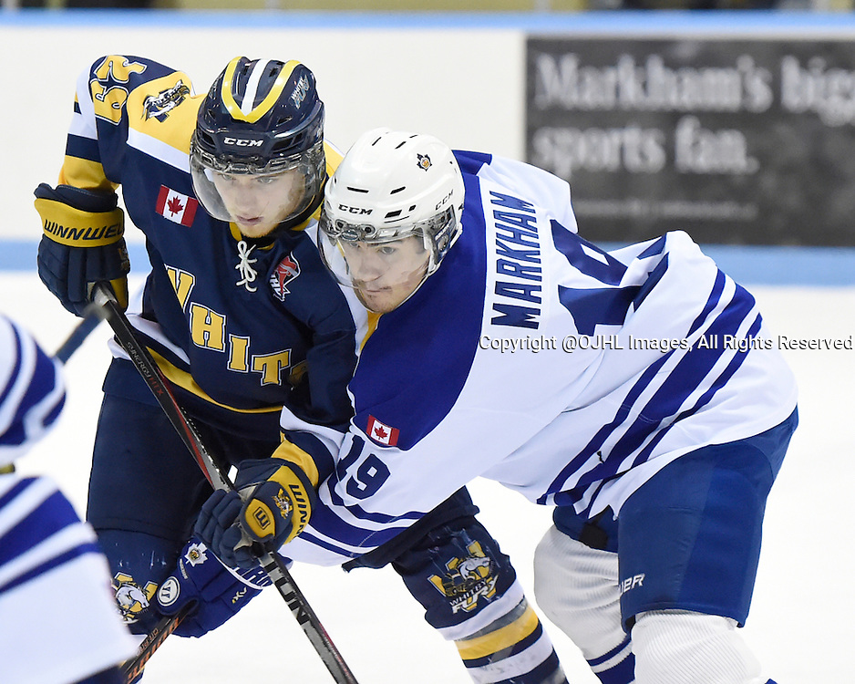 MARKHAM, - Mar 4, 2016 -  Ontario Junior Hockey League game action between Markham Royals and the Whitby Fury. Game 1 of the first round playoff series at the Markham Centennial Community Centre, ON. Ryan Heeps #29 of the Whitby Fury battles for control with Brett Markham #19 of the Markham Royals during the third period.<br /> (Photo by Andy Corneau / OJHL Images)