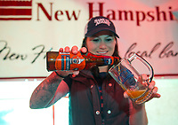Alicia Thomas pours a Sam Abams Octoberfest into a Veterans Count mug during Red, White and Brew fest at Funspot on Saturday afternoon.  (Karen Bobotas/for the Laconia Daily Sun)