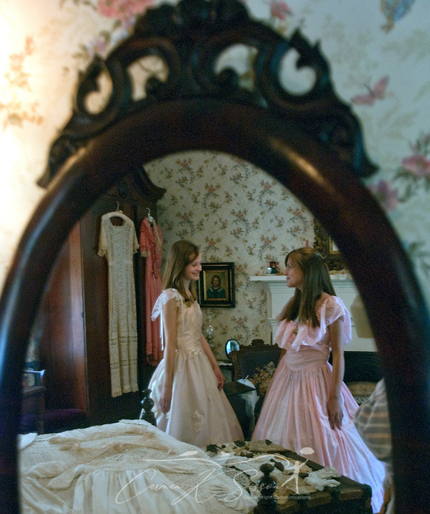 Caroline Ellis (left) and Anna Lee Fairley are reflected in a mirror at the Amzi Love Home in Columbus, Miss. April 17, 2010. The 1848 home, which has been featured in Fodor's Travel Guide and The New York Times Travel Magazine, was among nearly two dozen on tour during Columbus' annual Spring Pilgrimage. (Photo by Carmen K. Sisson/Cloudybright)