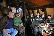 Newburgh, NY - A volunteer, center, talks about the galley on the Half Moon, a full-scale, operating replica of the Dutch ship of exploration that Henry Hudson sailed in 1609, that was docked on the Hudson River during the finale of the Newburgh Beacon Bay Quadricentennial celebration on Nov. 7, 2009. Groups of people toured the ship.