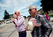 Jim Lee, right, looks on as a parade for veterans travels down Main Street in Valentine, NE July 27, 2013. Photo by Lauren Justice