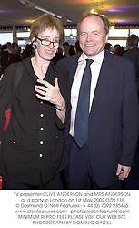 TV presenter CLIVE ANDERSON and MRS ANDERSON at a party in London on 1st May 2002.	OZN 118