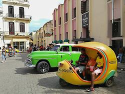 Cuban coco taxi. Yellow helmet-shaped. Old Havana, Cuba. Havana vieja, street.