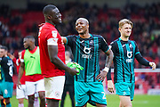 Swansea City forward Andre Ayew (22) shares a laugh with Barnsley defender Bambo Diaby (5) after full time during the EFL Sky Bet Championship match between Barnsley and Swansea City at Oakwell, Barnsley, England on 19 October 2019.