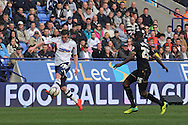Bolton Wanderer's  Lukas Jutkiewicz controls the ball on the wing against Wigan's Leon Barnett. Skybet football league championship match , Bolton Wanderers v Wigan Athletic at the Reebok stadium in Bolton on Saturday 29th March 2014.<br /> pic by David Richards, Andrew Orchard sports photography.