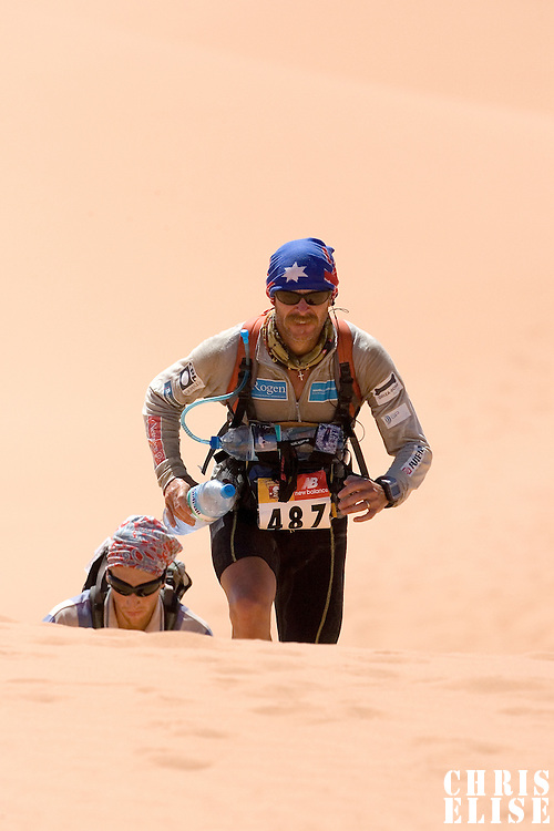 30 March 2007: #487 Shaun Mathew Bacon of Australia climbs a dune in erg Znaigui en route to check point 3 during fifth stage of the 22nd Marathon des Sables between west of Kfiroun and erg Chebbi (26.22 miles). The Marathon des Sables is a 6 days and 151 miles endurance race with food self sufficiency across the Sahara Desert in Morocco. Each participant must carry his, or her, own backpack containing food, sleeping gear and other material.