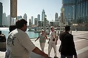 Tourists at Dubai Mall (Burj Khalifa in the background) in Dubai, UAE on February 10, 2010 Archive of images of Dubai by Dubai photographer Siddharth Siva