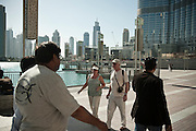 Tourists at Dubai Mall (Burj Khalifa in the background) in Dubai, UAE on February 10, 2010 Archive of images of Dubai by Dubai photographer Siddharth Siva