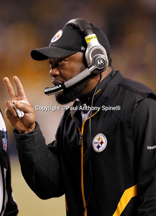 Pittsburgh Steelers head coach Mike Tomlin gestures with two fingers as he talks to officials during the NFL 2011 AFC Championship playoff football game against the New York Jets on Sunday, January 23, 2011 in Pittsburgh, Pennsylvania. The Steelers won the game 24-19. (©Paul Anthony Spinelli)