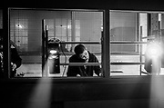 A young on the phone in a control booth, 'Scumoween', Whitgift Street, Lambeth, London, UK, 31 October, 2015