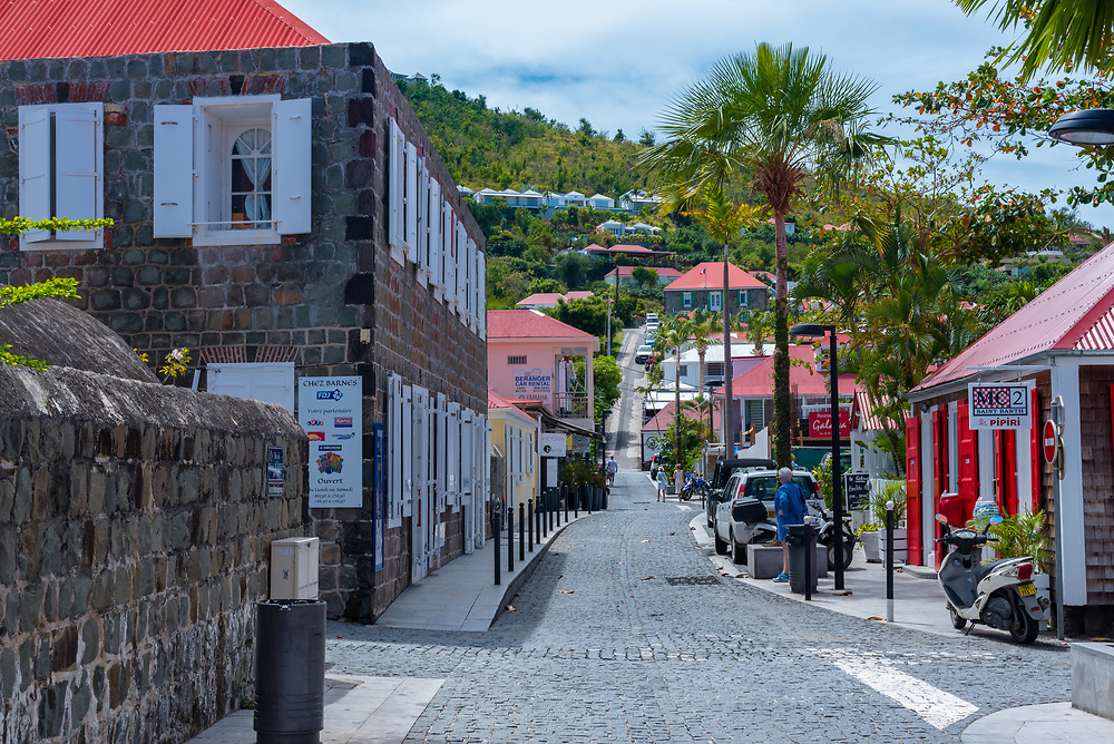 Gustavia, St Barths-- April 25, 2018. A pretty cobblestone street winds its way through a shopping district in Gustavia, St. Barths. Editorial Use Only.