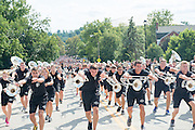 The Marching 110 lead a procession up Richland Ave following the First Year Student Convocation. Photo by Ben Siegel