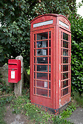 A well-painted postal box and a peeling K2 telephone box kiosk, on 10th September 2018, near Lingen, Herefordshire, England UK.