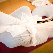 """TOKYO, JAPAN - JANUARY 29 : A woman wrapped with white cloth during a workshop called """"Otonamaki"""", which directly translates to adult wrapping in Tokyo, Japan on Sunday, January 29, 2017. Otonamaki is a Japanese therapeutic method meant to alleviate posture problems and stiffness. (Photo by Richard Atrero de Guzman/ANADOLU Agency)"""