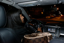 Junanita Bynum sits behind the wheel of a Toyota Camry as she makes here way through West Philadelphia to pick up two colleagues before commuting to work. (Bastiaan Slabbers/for PhillyVoice)